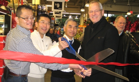 Mayor Jack Froese helps Charlie, Robert and Peter cut the ribbon to open Lee's Market
